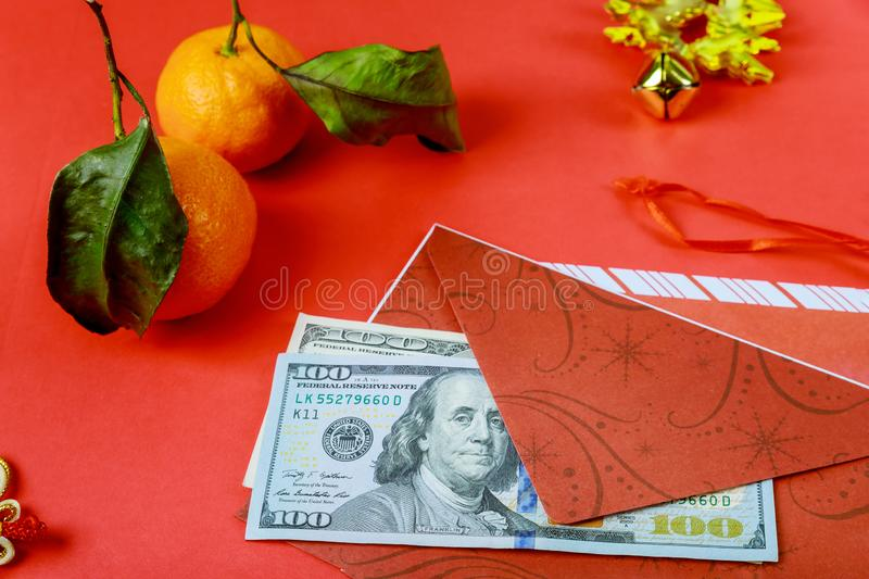 Chinese New Year background. US dollars Chinese good luck symbol on red stock image