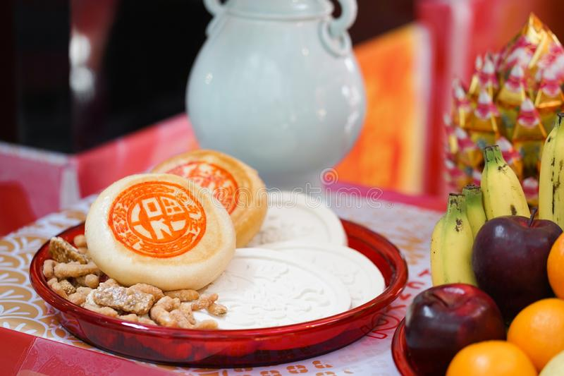 Chinese New Year. A bakery and dessert served at the Chinese New Year festival, next to fresh fruits stock photography