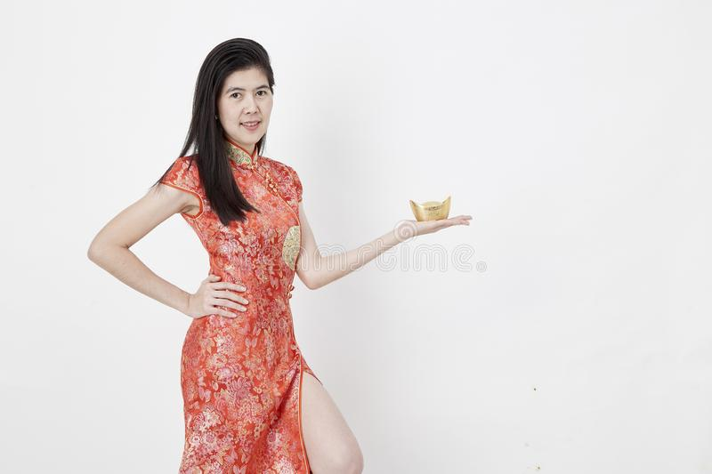 Chinese New Year, business woman holding gold ingot stock images