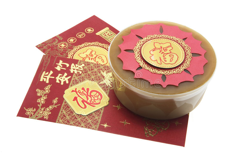 Chinese New Year Cake and Red Packets stock image