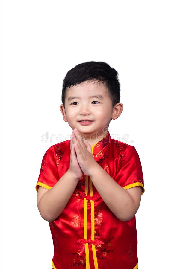 Chinese New Year Concept, Cute Asian boy in red traditional Chinese suit isolated on white with clipping path stock image