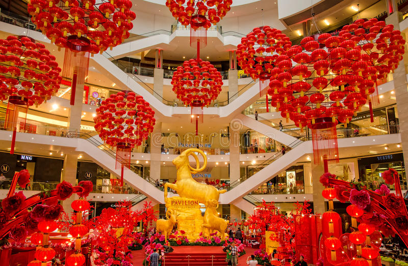 Chinese New Year decoration in KL Pavilion. Kuala Lumpur,Malaysia - February 26,2015 : The golden goats and Chinese New Year decoration in the centre court of stock images