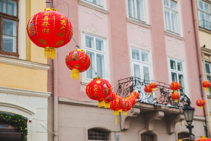 Chinese new year decoration lights at european city streets. Holidays concept stock photography