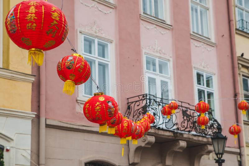 Chinese new year decoration lights at european city streets. Holidays concept royalty free stock photography