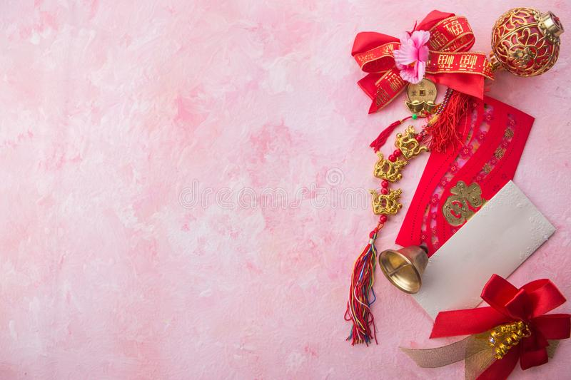 Chinese new year decoration on pink wooden background with copy space. stock images
