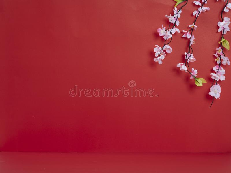 Chinese new year decoration on red background. Chinese new year 2020. Happy chinese new year or lunar new year. Flowers of good fortune on red background royalty free stock images