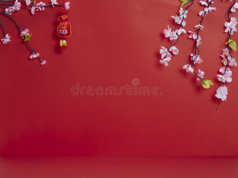 Chinese new year decoration on red background. Chinese new year 2020. Happy chinese new year or lunar new year. Flowers of good fortune on red background stock photo