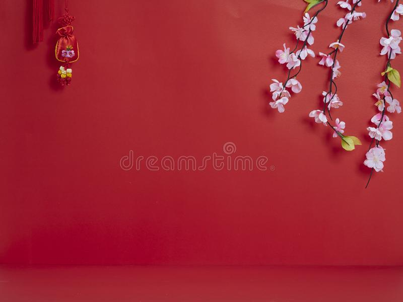 Chinese new year decoration on red background. Chinese new year 2020. Happy chinese new year or lunar new year. Flowers of good fortune on red background stock image