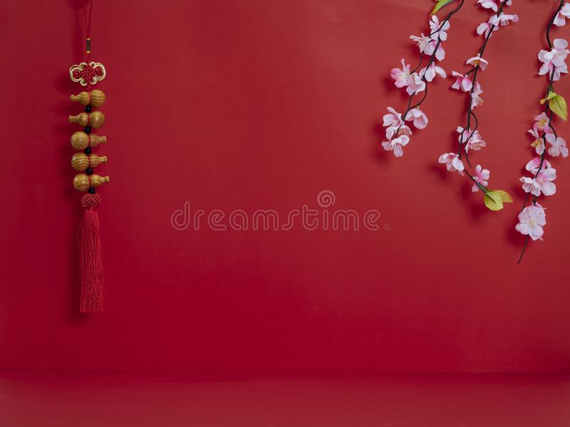 Chinese new year decoration on red background. Chinese new year 2020. Happy chinese new year or lunar new year. Flowers of good fortune on red background stock images