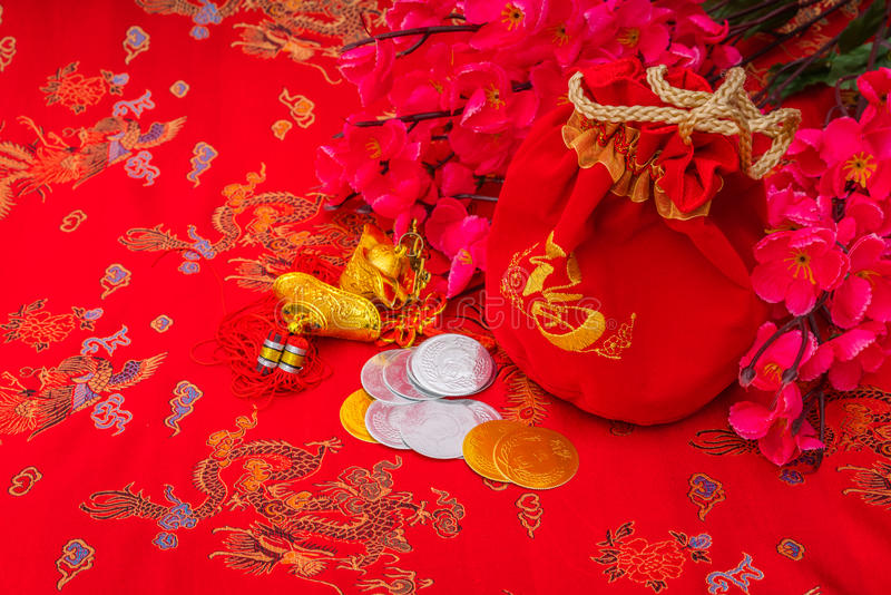 Chinese new year decoration on red fabric background .,Chinese c stock photos