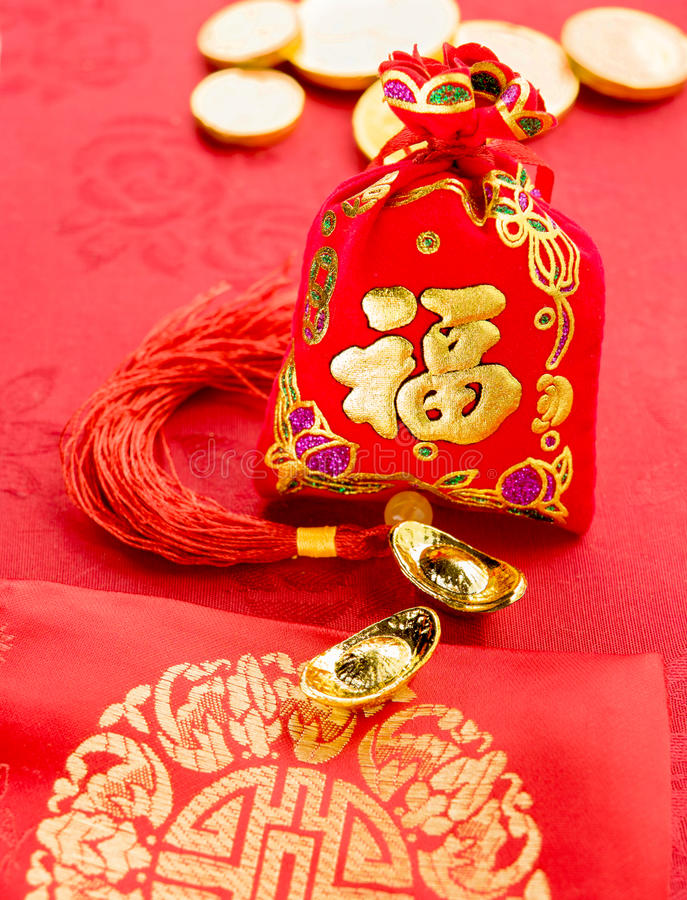 Chinese new year decoration: red felt fabric packet or ang pow w royalty free stock photo