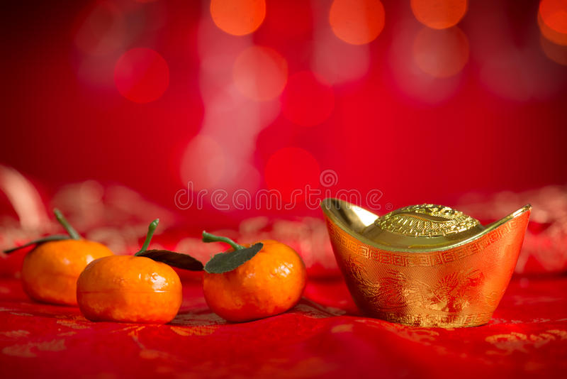 Chinese New Year decorations gold ingot and mandarin orange royalty free stock photos