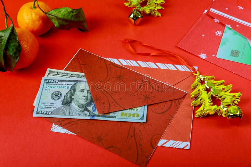 Chinese New Year Decorations red envelope and American Dollar happy new year or fortune or good luck wishes stock photos