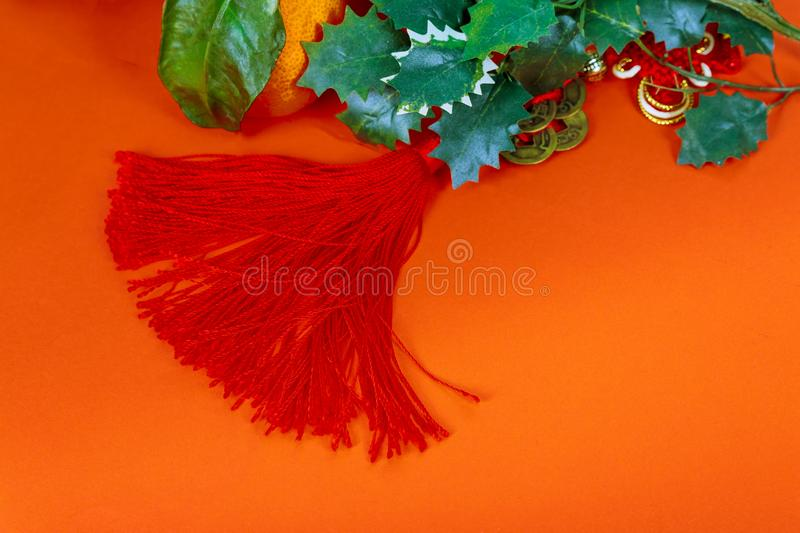 Chinese new year decorations, on red glitter decorations and tangerines stock photography