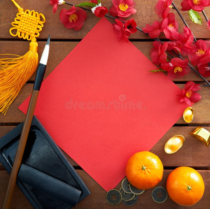 Chinese new year decorations. Top view of Chinese new year decorations with a blank red paper as copy space stock photos