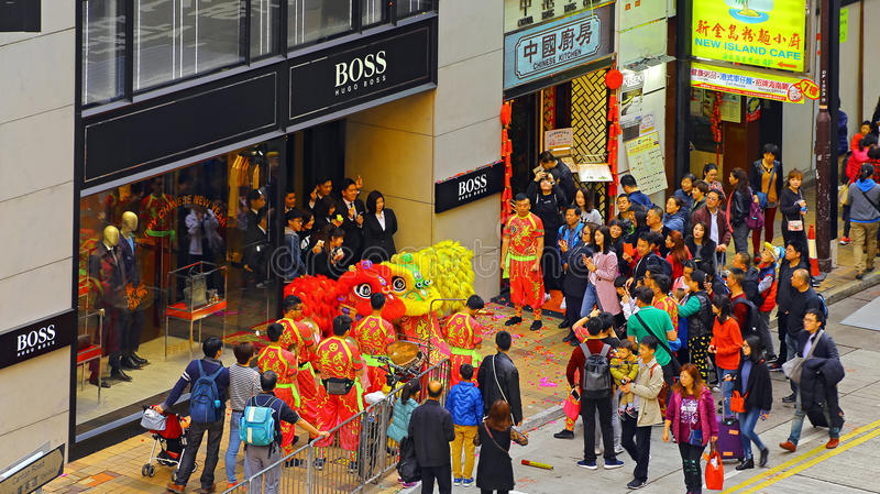 Chinese new year dragon dance at hugo boss boutique. Staff of german cosmetics and fashion boutique hugo boss enjoying the dragon dance performance during royalty free stock photo