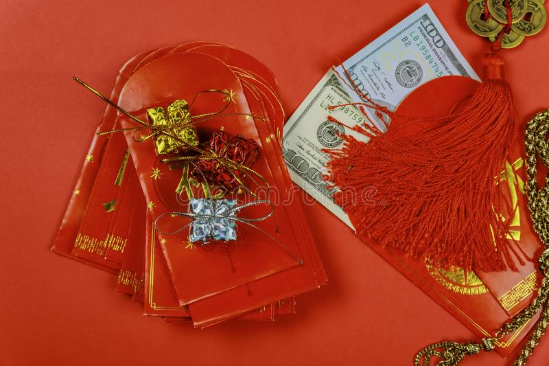 Chinese new year festival decorations, and pow or red packet with dollars inside stock photos