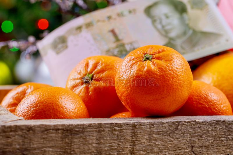 Chinese new year festival decorations orange wood basket Chinese yuan banknotes royalty free stock photos