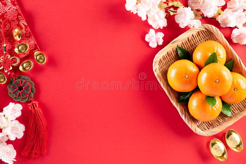 Chinese new year festival decorations pow or red packet, orange and gold ingots or golden lump on a red background. Chinese. Characters FU in the article refer royalty free stock photos