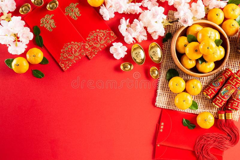 Chinese new year festival decorations pow or red packet, orange and gold ingots or golden lump on a red background. Chinese. Characters FU in the article refer royalty free stock images
