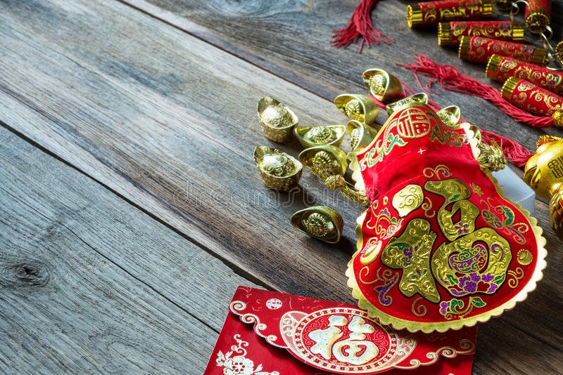 Chinese new year festival decorations on wooden table. Chinese new year festival decorations on wooden table royalty free stock photos