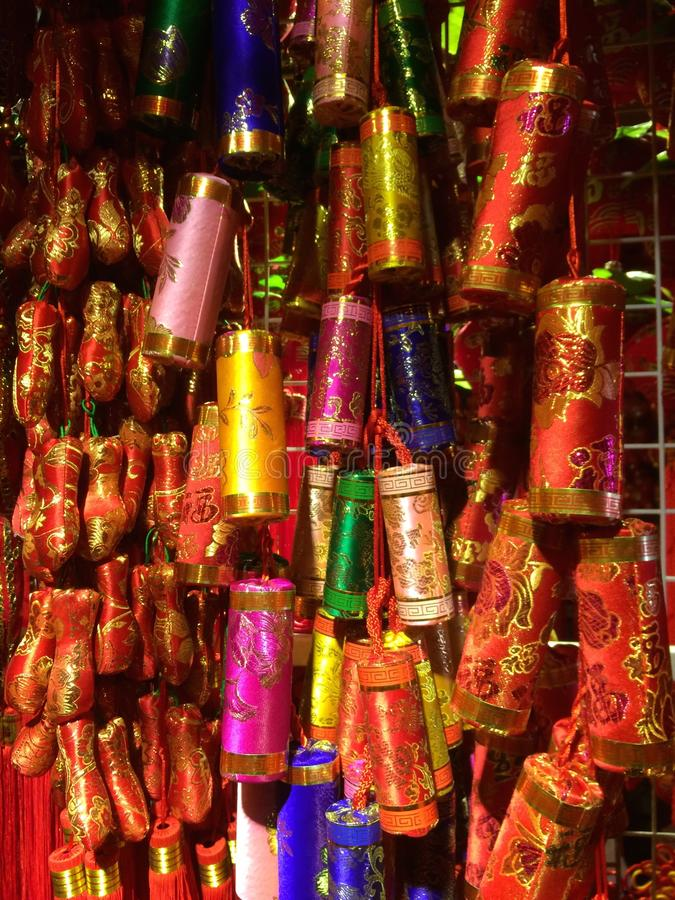 Chinese New Year Fire Cracker Decoration Shanghai. Chinese New Year decorations of hanging fire-crackers in hidden Shanghai shop. To fight off evil spirits and royalty free stock photos