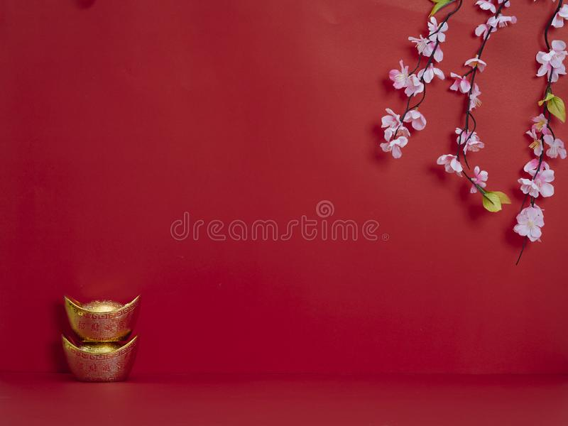 Chinese New Year 2020. Flowers and chinese gold ingot. Chinese new year 2020 festival. Happy chinese new year or lunar new year. Flowers of good fortune and lump stock images