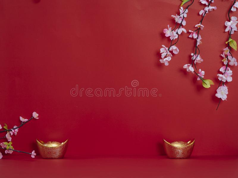 Chinese New Year 2020. Flowers and chinese gold ingot. Chinese new year 2020 festival. Happy chinese new year or lunar new year. Flowers of good fortune and lump stock image