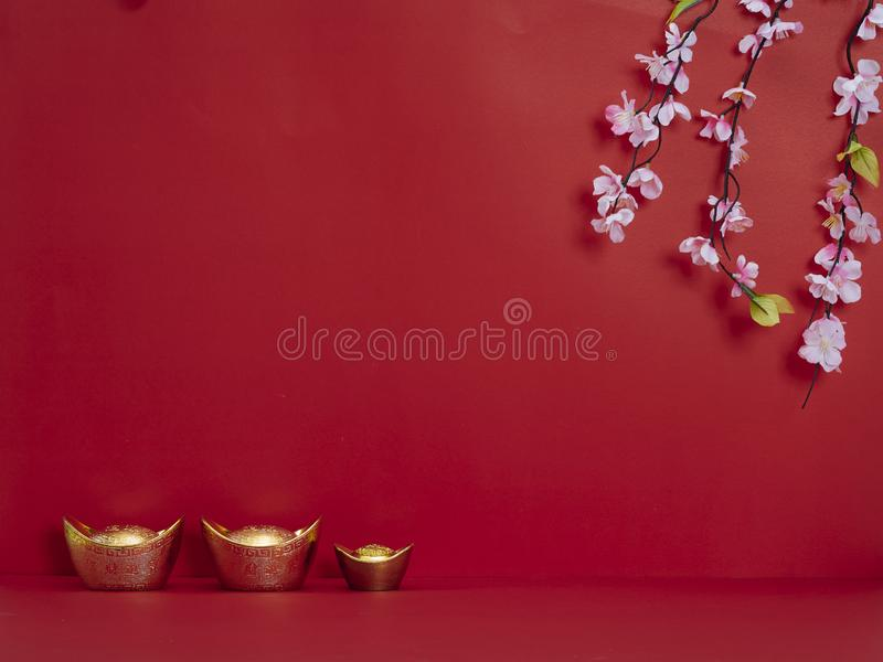Chinese New Year 2020. Flowers and chinese gold ingot. Chinese new year 2020 festival. Happy chinese new year or lunar new year. Flowers of good fortune and lump stock photos