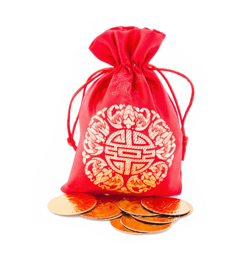 Chinese New Year Gift Bag And Gold Ingot Ornament Stock Photo