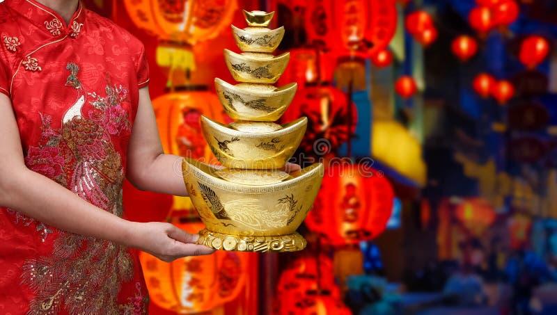 Chinese new year gold ingot qian stock photo