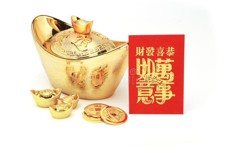 Chinese new year gold ingots and red packet royalty free stock images