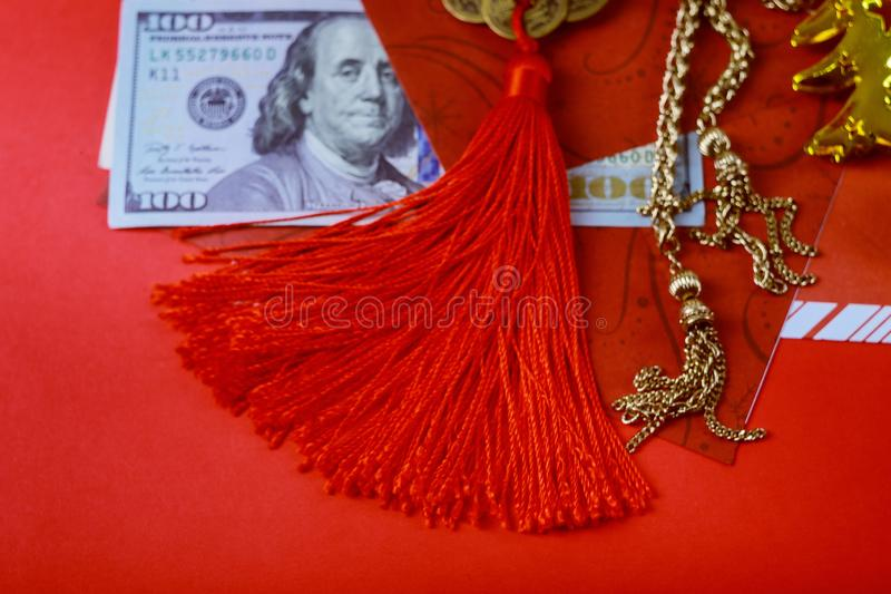 Chinese new year greeting with happy money envelopes, US dollar banknotes in red traditional envelopes stock image
