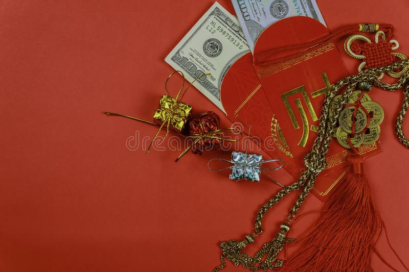 Chinese new year greeting red envelope, lucky dollar money for gift stock images