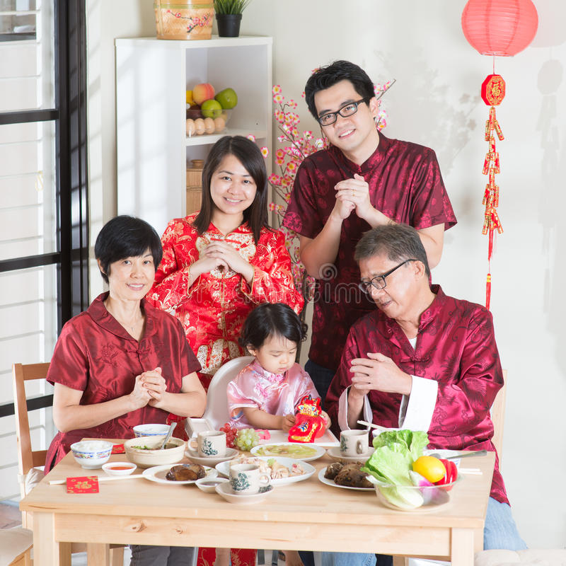 Chinese New Year group photo. Spring seasons Chinese New Year, reunion dinner. Happy Asian Chinese multi generation family with red cheongsam greeting while royalty free stock images
