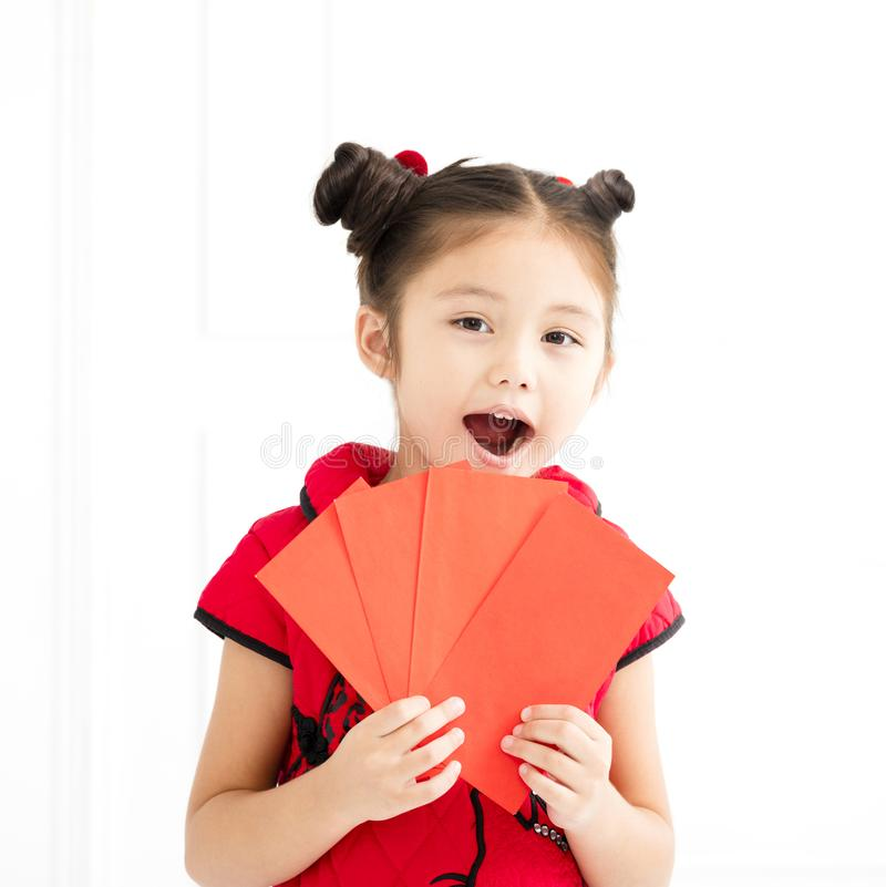 Chinese new year. little girls holding red envelope. Happy chinese new year. little girls holding red envelope stock photo