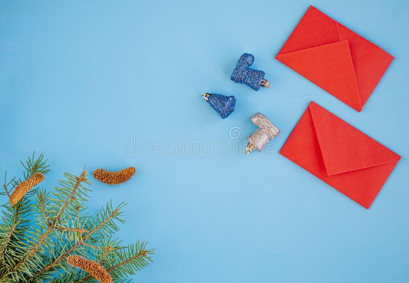 Chinese New year and Lunar New year. Branches of spruce, red envelopes with pocket money. Christmas decorations, spices on blue background.Flat position, top royalty free stock photography