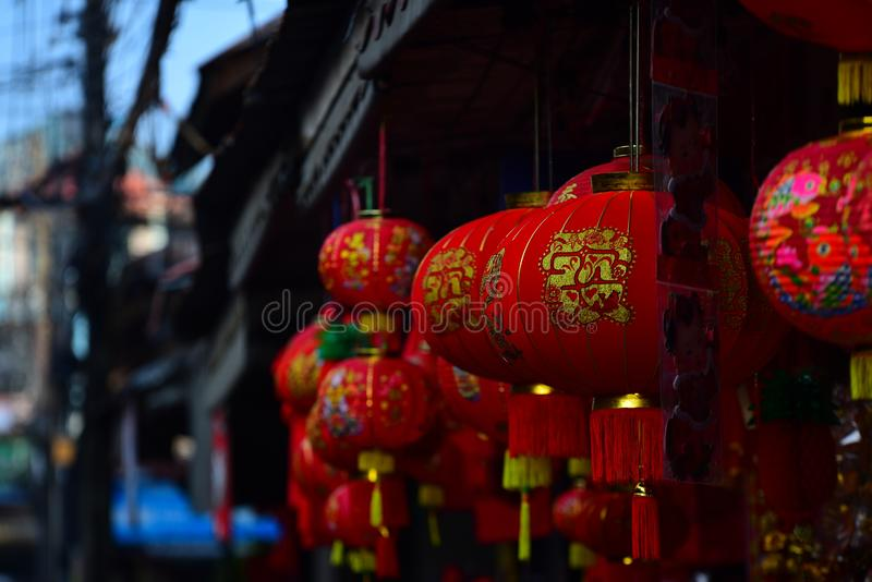 Chinese New Year. The New Year`s Day of the Chinese people. Lamps and red garments for use during Chinese New Year. The New Year`s Day of the Chinese people stock images