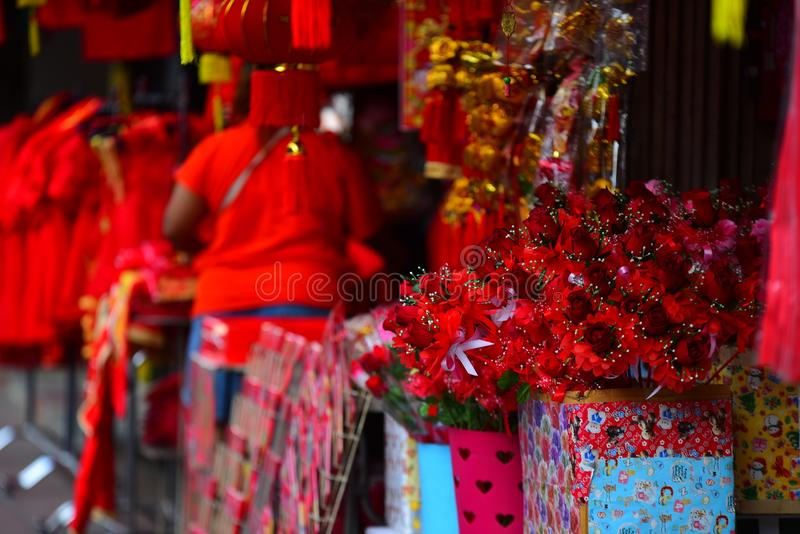 Chinese New Year. The New Year`s Day of the Chinese people. Lamps and red garments for use during Chinese New Year. The New Year`s Day of the Chinese people stock photo