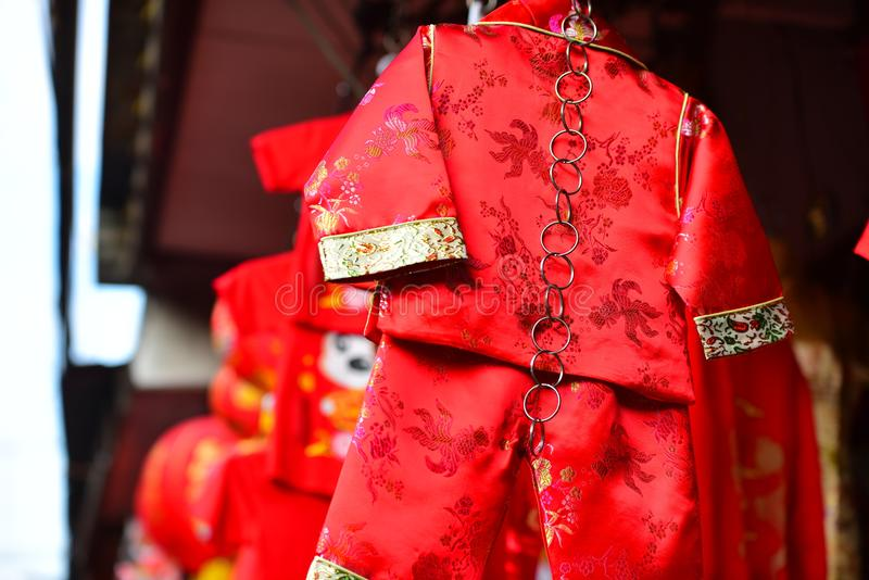 Chinese New Year. The New Year`s Day of the Chinese people. Lamps and red garments for use during Chinese New Year. The New Year`s Day of the Chinese people royalty free stock photos