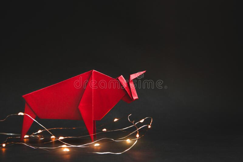 Chinese new year 2021 year of the ox , red. Bull on black background. stock photos