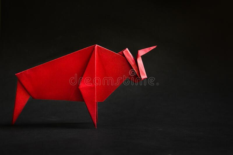 Chinese new year 2021 year of the ox , red. Bull on black background. stock images