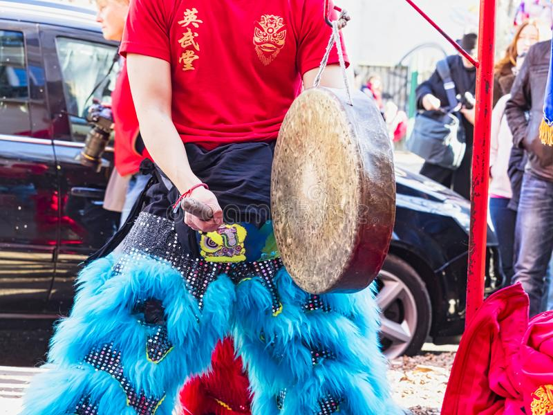 Chinese new year 2019 Paris France - Musican playing gong in street royalty free stock images