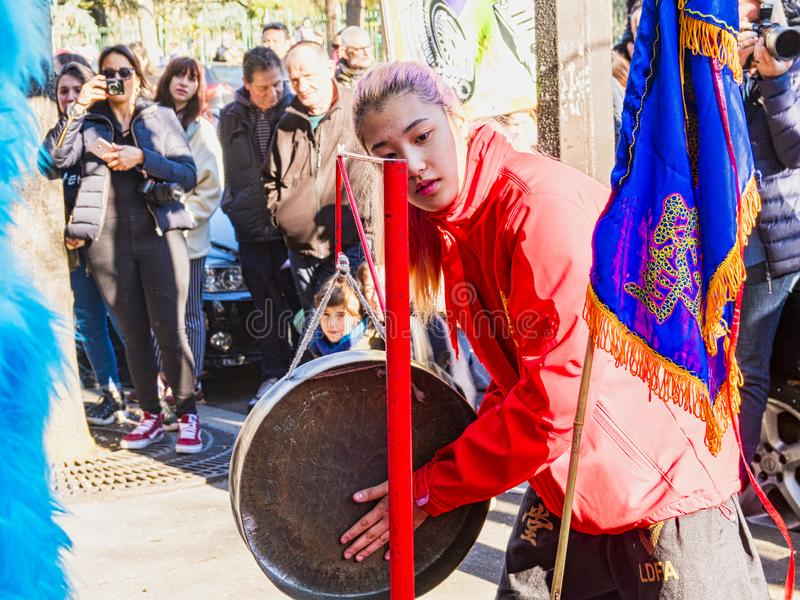 Chinese new year 2019 Paris France - Musican playing gong in street royalty free stock photos