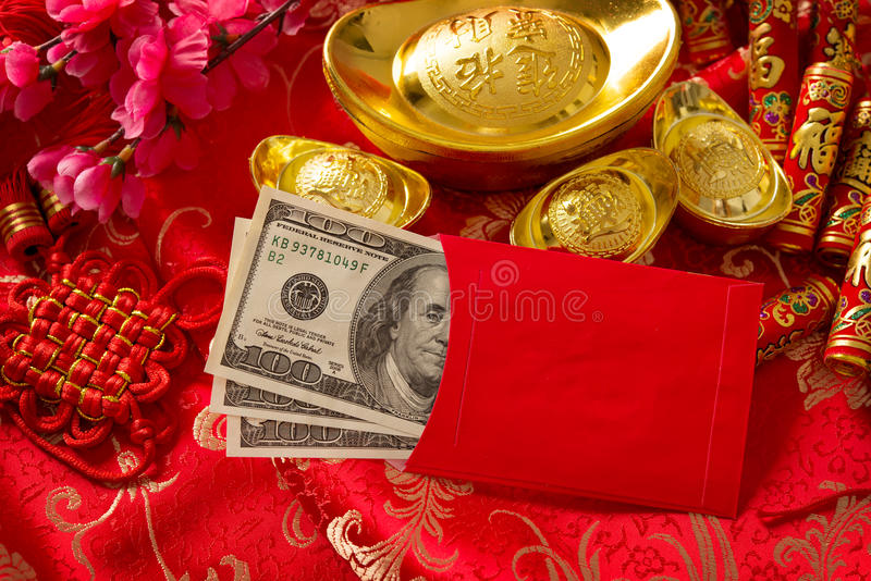 Chinese new year red envelope with dollars inside. Chinese new year festival decorations, red packet or ang pow is given to children and elders during chinese stock photo