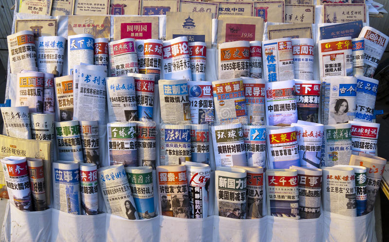 Chinese newspapers. BEIJING - MARCH 12: Chinese newspapers in a newsstand on March 12, 2012 in Beijing, China