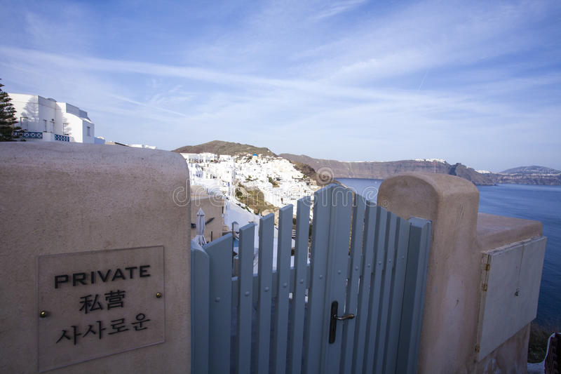 Chinese - no entry - sign on a gate in Oia, Santorini, Greece. Europe royalty free stock photography
