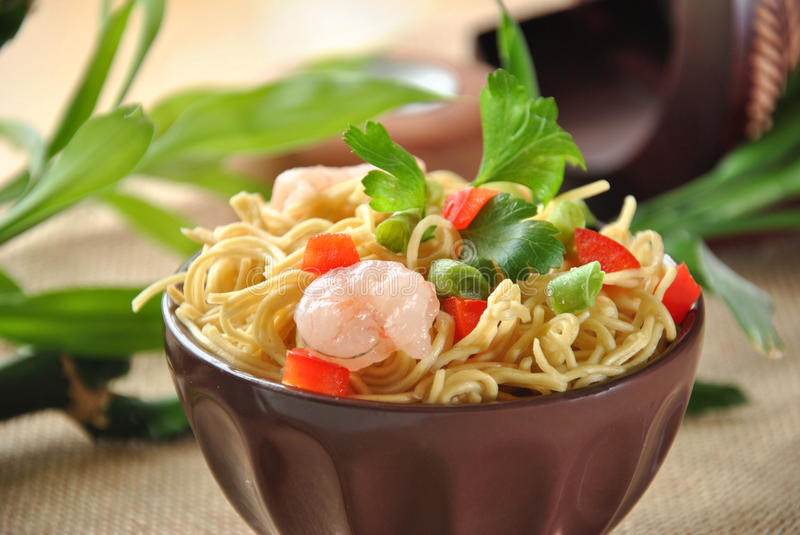 Chinese noodle dish. With shrimp and vegetables stock photography