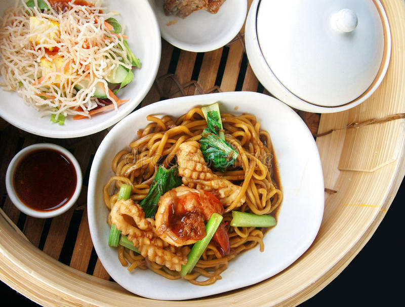 Chinese noodle stir set. Chinese noodle stir with squid and shrimp royalty free stock images
