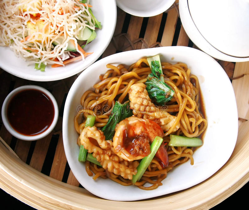 Chinese noodle stir with squid and shrimp. Set, Chinese noodle stir with squid and shrimp royalty free stock photos